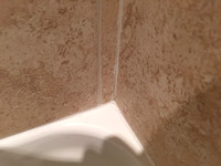 Crack in the grout inside of shower.